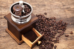 Vintage coffee bean grinder and fresh ground coffee Royalty Free Stock Photo
