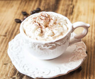 Vintage Coffee Cup with Cappuccino and Whipped Cream Royalty Free Stock Images