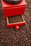 Vintage coffee grinder. On pile of beans Stock Images