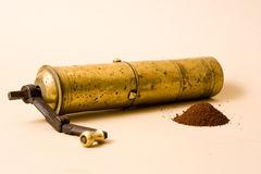 Vintage Coffee Grinder. Vintage brass coffee grinder with coffee powder Royalty Free Stock Photo