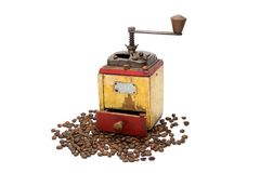 The Vintage coffee grinder with coffee beans. Vintage coffee grinder with coffee beans Stock Image