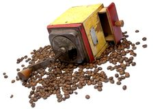 The Vintage coffee grinder with coffee beans Royalty Free Stock Photos