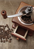 Vintage coffee grinder and beans Stock Photos