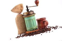 Vintage coffee grinder and coffee beans Royalty Free Stock Images