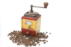 The Vintage coffee grinder with coffee beans. Vintage coffee grinder with coffee beans Stock Photography