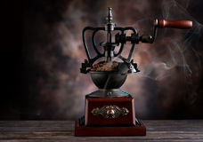 Vintage coffee grinder and coffee beans. Coffee grinder and coffee beans with copy space for text on a dark texture Stock Photos