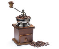 Vintage coffee grinder with coffee beans. Isolated on white Royalty Free Stock Photo