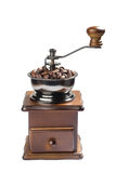 Vintage coffee grinder with coffee beans Stock Photo