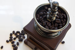 Vintage coffee grinder with coffee beans Royalty Free Stock Image