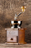 Vintage coffee grinder with coffee beans Royalty Free Stock Photography