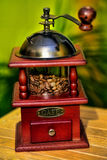 Vintage coffee grinder and coffee on green background. Vintage coffee grinder and coffee on green background royalty free stock image