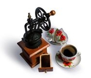 Vintage coffee grinder and cup of coffee Royalty Free Stock Photography