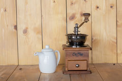 Vintage coffee grinder and jar. Of sweet water Royalty Free Stock Photo