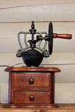 Vintage coffee grinder. Made of wood and black wrought metal Royalty Free Stock Photography