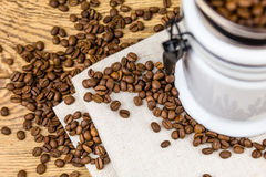 Vintage coffee grinder mill with coffee beans. Stock Photo