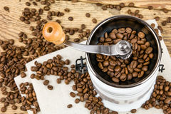 Vintage coffee grinder mill with coffee beans. Royalty Free Stock Photo