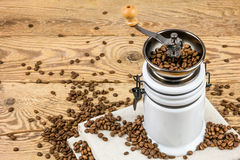 Vintage coffee grinder mill with coffee beans. Royalty Free Stock Photos