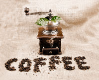 Vintage coffee grinder and sign Stock Photo