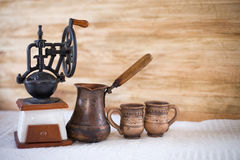 Vintage coffee grinder turkish. And cup Stock Images