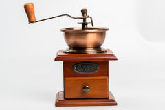 Vintage coffee grinder on white. Background Stock Photography
