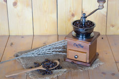 Vintage coffee grinder. On wooden background Royalty Free Stock Photos