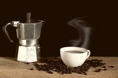 Vintage coffee maker pot with coffee cup Royalty Free Stock Images