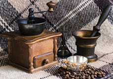 Vintage coffee mill with cup. Vintage coffee mill with silver cup Stock Photos