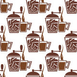Vintage coffee mills with cups seamless pattern. Coffee seamless pattern with vintage manual coffee mills and cups filled brown hot drink on white background for Royalty Free Stock Photo
