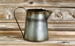 Vintage coffee pot on rustic wooden boards Stock Images