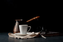 Vintage coffee pot and spoon, beans scattered around, with copys Royalty Free Stock Images