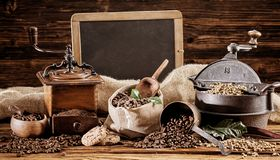 Vintage coffee roaster and grinder with beans stock photography