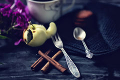 Vintage coffee spoon and fruit fork. Cinnamon, coffee and macaroni on the old table. Royalty Free Stock Photo