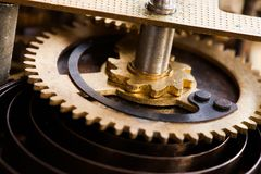 Vintage cog wheel gear teeth macro view. Shallow depth field, selective focus.  Royalty Free Stock Images