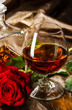 Vintage cognac with rose Royalty Free Stock Photo