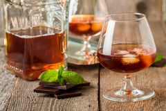 Vintage cognac still life with chocolate Stock Image