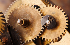 Vintage cogs gears wheels collection set. Aged clockwork mechanism parts macro view. Different cogwheels teeth shapes. Objects with textured metal surface Stock Photography