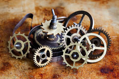 Vintage cogs gears wheels collection set. Aged clockwork mechanism parts macro view. Different cogwheels teeth shapes. Objects with textured metal surface Stock Photos