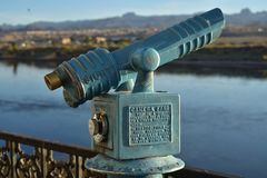 Vintage coin operated telescope instructions cast into metal. Vintage antique old fashioned coin operated telescope, outdoors, along Colorado river bank ,for Stock Image