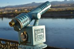 Vintage coin operated telescope instructions cast into metal. Vintage antique old fashioned coin operated telescope, outdoors, along Colorado river bank ,for Royalty Free Stock Photos