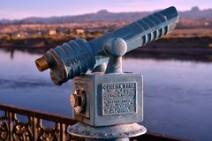 Vintage coin operated telescope. Vintage antique old fashioned coin operated telescope outdoors along Colorado river bank for magnified viewing of scenery Stock Photo