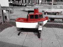 Vintage Coin Riding Boat. In black and white with splashes of red royalty free stock photo