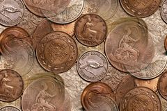 Vintage coins background abstract. Vintage coin background abstract with New Zealand, Canadian & English coins in forefront; Straits Settlement, Hong Kong, & Stock Image