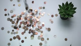 Vintage coins droping on the white table stock video