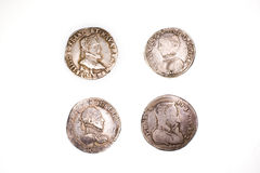 Vintage  coins with portraits on a white background Royalty Free Stock Photography