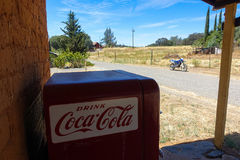 Vintage Coke Machine and Motorbike in Small USA Town Stock Photos