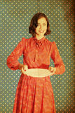 Vintage collage with beautiful young woman. With white plate, retro Royalty Free Stock Image