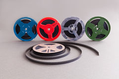 Vintage collection 8 mm cinema film reel. Retro design colorful celluloid accessories for home video projector. Gray Stock Image