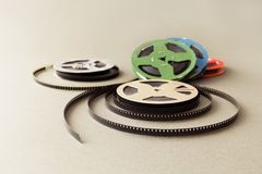 Vintage collection 8 mm cinema film reel. Retro design colorful celluloid accessories for home video projector. Vintage collection 8 mm cinema film reel. Retro Stock Photography