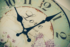 Vintage color clock and focus on moving clockwise Royalty Free Stock Photo