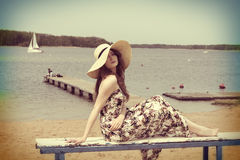 Vintage color effect summer shot of girl on the beach Stock Images